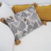 Cojin Suri - 60x40 - conchas marinas - algodon - mostaza y crudo - borlas